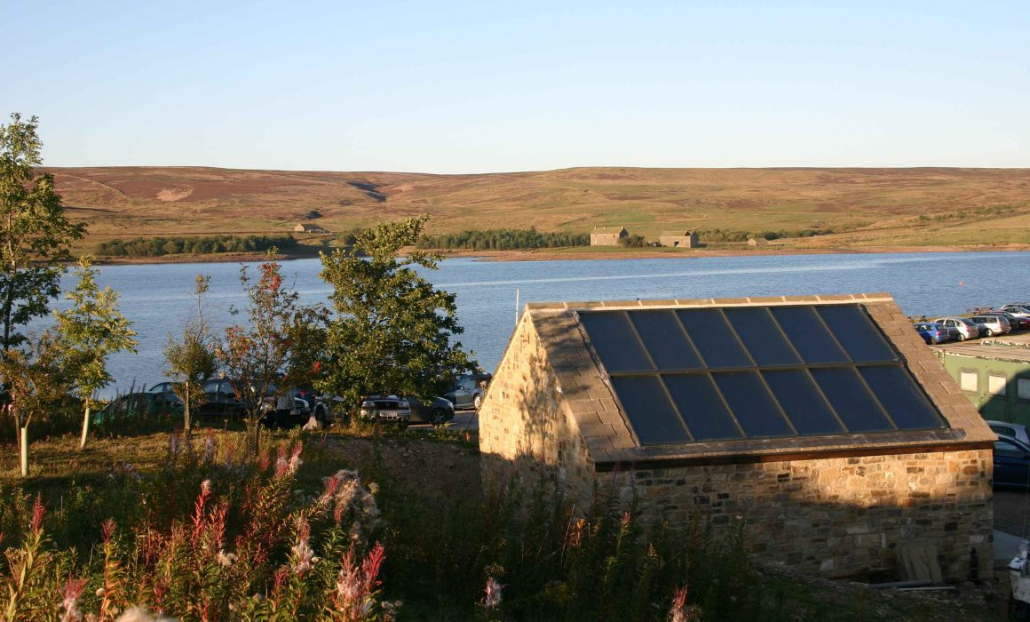 TiSUN Solar Heat Europe – TiSUN's large flat FI collectors on Yorkshire Dales Sailing Club's store room roof